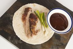 Hoisin Duck. With rice wrap rice and spring onions against grey royalty free stock photos