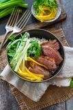 Hoisin duck with mango, spring onion, rocket lettuce salad and rice. Top view royalty free stock photo