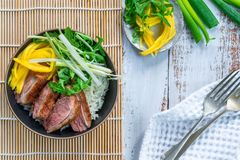 Hoisin duck with mango, spring onion, rocket lettuce salad and rice. Top view stock photos