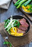 Hoisin duck with mango, spring onion, rocket lettuce salad and rice. Top view stock image