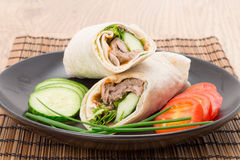 Hoisin duck wrap sandwich. Served with tomato, cucumber and chive royalty free stock photo
