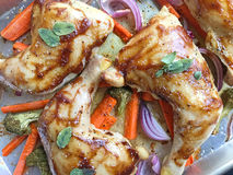 Hoisin-sauce roasted chicken quarters. Chicken quarters with hoisin sauce and vegetables stock images