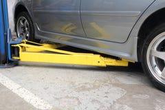 Hoist for car /car lift. Hoist for car , Lift up the car for maintenance the car stock photo