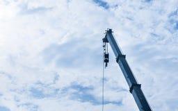 Hoist crane hook head. With blue sky cloud background stock photography