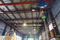 Hoist with overhead crane and scales in warehouse Royalty Free Stock Photography