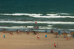 Hoisted red colors on sea beach. Valencia, Spain. 03-09-2015 Royalty Free Stock Photography