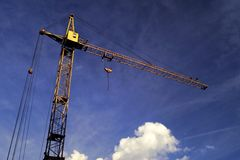 Hoisting crane Stock Images
