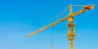 Hoisting crane and blue sky Royalty Free Stock Images