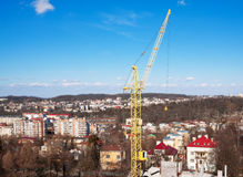 Hoisting crane in the city center Stock Photo