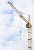 Hoisting crane on a construction site Royalty Free Stock Images