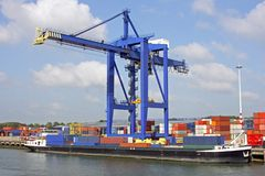 Hoisting crane with freighter. In harbor of Rotterdam the Netherlands Stock Photo