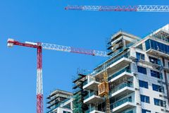Hoisting crane and house Stock Image