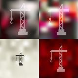 Hoisting crane icon on blurred background Stock Photos