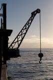 Hoisting crane silhouette Stock Image