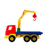 Hoisting crane toy on a white isolated Royalty Free Stock Images