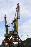 Hoisting cranes in the commercial port Royalty Free Stock Image