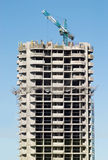 Hoisting tower crane in building action Stock Photography