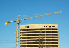 Hoisting tower crane and construction building Stock Images