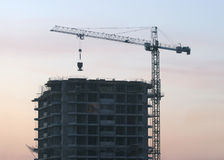 Hoisting tower crane elevates construction detail Stock Image