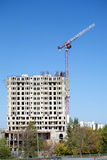 Hoisting tower crane and top of construction building Royalty Free Stock Photography