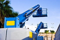 Hoists. Two hoists are waiting for lifting  workers Royalty Free Stock Photo