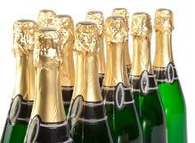 Hoja amarilla en las botellas de cristal verdes Foto de archivo libre de regalías