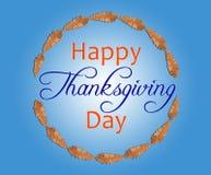 Hoja de Brown en círculo con día feliz de la acción de gracias dentro en azul Fotos de archivo
