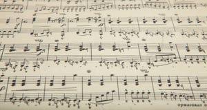 Hoja de música vieja con las notas, fondo Foto de archivo
