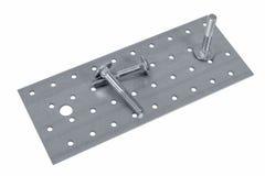 Hoja de metal y tornillo y x28 perforados; bolt& x29; nueces Foto de archivo