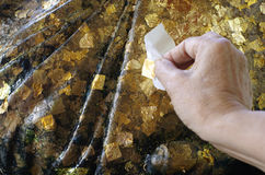 Hoja de oro en la estatua Imagenes de archivo