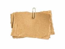 Hoja de papel de Brown para las notas y el clip de papel Imagenes de archivo