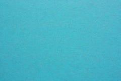 Hoja de papel o madera contrachapada en blanco en colores azules Foto de archivo libre de regalías