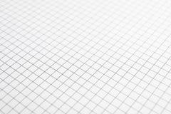 Hoja del cuaderno con textura de la rejilla como fondo fotografía de archivo libre de regalías
