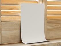 Hoja del Libro Blanco cerca de la ventana con los obturadores representación 3d Imágenes de archivo libres de regalías