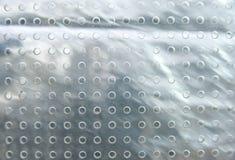Hoja del plexiglás con los agujeros. Foto de archivo libre de regalías