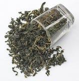Hoja del té y del vidrio Foto de archivo libre de regalías