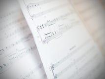 Hoja escrita de la notación de música Imagen de archivo
