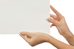 Hoja limpia de papel en manos femeninas Imagenes de archivo