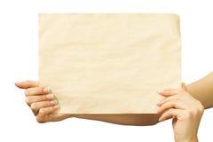 Hoja limpia de papel en manos femeninas Fotografía de archivo
