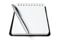 Hoja limpia del cuaderno aislada en blanco. Horisontal. Foto de archivo libre de regalías