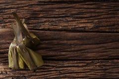 Hoja tailandesa del plátano del postre sabrosa en fondo de madera Fotos de archivo libres de regalías
