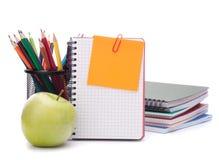 Hoja y manzana en blanco del cuaderno. Imagen de archivo