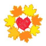 Hojas de arce del otoño con el corazón Foto de archivo libre de regalías