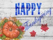 Hojas de la calabaza y de otoño y día de la acción de gracias en la tabla blanca Foto de archivo