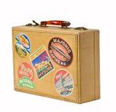 Hojas de ruta (traveler) de mundo - una maleta retra de la vendimia Fotos de archivo libres de regalías