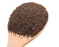 Hojas de té procesadas en la cuchara de madera III Fotos de archivo