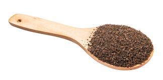 Hojas de té procesadas en la cuchara de madera IV Fotografía de archivo