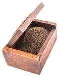 Hojas de té secadas en la caja de madera X Imagen de archivo