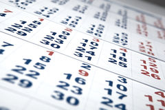 Hojas del calendario de pared con el número de días Fotos de archivo