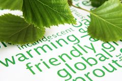 Hojas del verde y concepto del calentamiento del planeta Foto de archivo libre de regalías